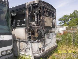 2011 MCI D4505, FIRE DAMAGED