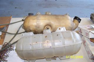 2 used Freightliner coolant expansion tanks.